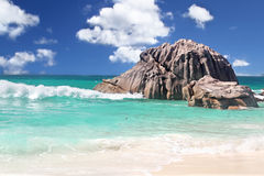 Breaking Waves in The Seychelles. Breaking Waves on Boulders on The stunning Island of La Dique in The Seychelles Stock Image