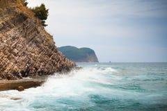 Breaking waves on stone Adriatic Sea coast Stock Photos