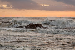 Breaking waves at sunset Royalty Free Stock Photography