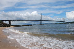 Breaking Waves Under Forth Road Bridge Stock Image