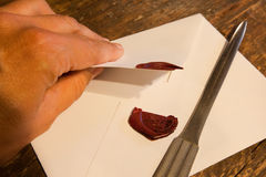 Breaking a wax seal Stock Image