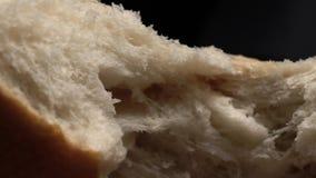 Breaking white bread. Super Macro. Narrow area of sharpness. Slow motion.