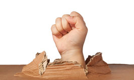 Breakout. Hand out of a hole showing a fist pump sign stock photo