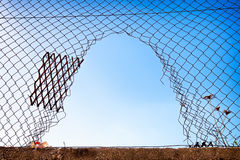 Breakout. Hole at a wiremesh - photo royalty free stock image