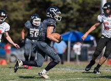 Breakout Run. Football action with Arcata vs. Central Valley High School in Northern California royalty free stock photo
