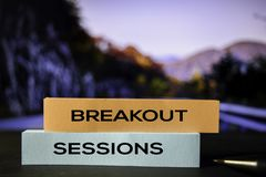 Breakout Sessions on the sticky notes with bokeh background stock photo