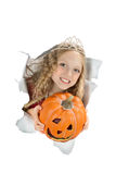 Breakthrough beautiful princess holding a pumpkin. Royalty Free Stock Images