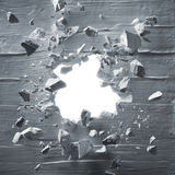 Breakthrough. Cracked wall with explosion hole and debris stock images