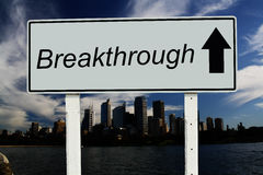 Breakthrough go straight sign. Breakthrough - Road Sign. On dramatic blue sky, city, and clouds background royalty free stock image
