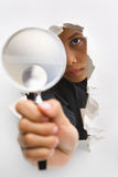 Breakthrough in investigation process. Detective holding magnifying glass from cracked wall means breakthrough in investigation - one of the breakthrough series stock images