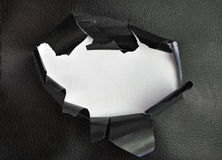 Breakthrough leather hole. Breakthrough leather hole with white background royalty free stock photography