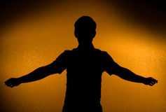 Breakthrough - male silhouette. With opened arms (back light stock photo