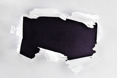Breakthrough paper hole. Breakthrough paper hole with black textured background Royalty Free Stock Photography
