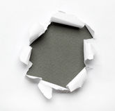 Breakthrough paper hole Stock Images