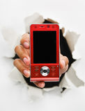 Breakthrough in telecommunication technology. Hand holding new red cell phone mean breakthrough in telecommunication technology - one of the breakthrough series royalty free stock images