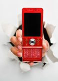 Breakthrough in telecommunication technology. Hand holding new red cell phone mean breakthrough in telecommunication technology innovation - one of the royalty free stock photography