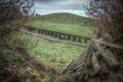 Breakthrough view on aqueduct covered with moss stock image