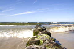 Breakwater. In the Sea and blue sky Stock Photos