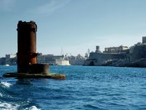 Breakwater. Ruin left over from WWII bombed bridge in Grand Harbour, Malta Stock Image