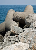Breakwater. With concrete blocks - tetrapods Royalty Free Stock Images
