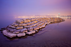 Breakwater. A Breakwater in Lake Geneva at dawn Royalty Free Stock Photography