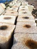 Breakwater. Long concrete Breakwater,concrete blocks along beach Stock Image
