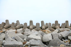 Breakwater. Outdoor - concrete tetrapods on the beach near a port under construction Royalty Free Stock Image