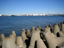 Breakwater. Breakwater, port and white clouds Royalty Free Stock Photo