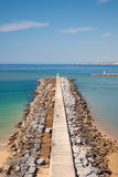 Breakwater in Algarve beach, Portugal Stock Images