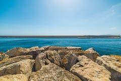 Breakwater in Alghero harbor Stock Images