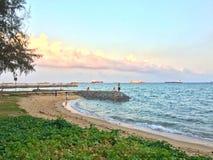 Breakwater along beach Stock Photo