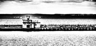 The breakwater. Artistic look in black and white. Royalty Free Stock Photography