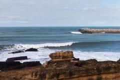 Breakwater atAtlantic coast, Ericeira, Portugal. Stock Photos