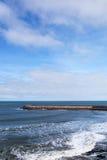 Breakwater atAtlantic coast, Ericeira, Portugal. Royalty Free Stock Image
