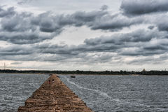 Breakwater in Baltic Sea, Latvia. With Walking People in Background Stock Photos