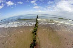 Breakwater and beach on Baltic coast Royalty Free Stock Photo