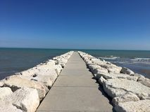 Horizons. Breakwater on the beach, Lido Island, Venice, Italy stock images