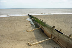 Breakwater, beach and sea Stock Images