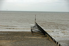 Breakwater, beach and sea Royalty Free Stock Images