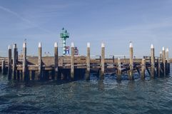 Breakwater with beacon at Oudeschild port. Breakwater with beacon in Oudeschild port at Texel island on sunny october day royalty free stock image
