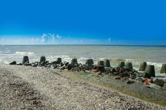 breakwater on black sea shore. Bright sunny day. royalty free stock images