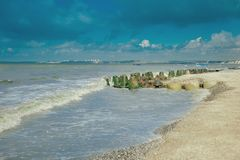 breakwater on black sea shore. Bright sunny day. royalty free stock photography