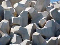 Breakwater blocks. Breakwater with concrete blocks - tetra pods in the harbour Stock Photo
