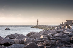 Breakwater and boat Royalty Free Stock Images