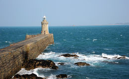 Breakwater and breakers. Guernsey Stock Image