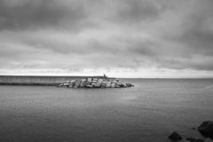 Breakwater in the calm ocean Stock Images