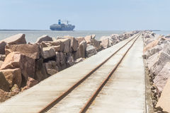 Breakwater at Cassino beach. Ship navigating to the ocean using Rio Grande channel and breakwater at Cassino beach stock photos