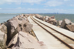 Breakwater at Cassino beach. Trail over breakwater with cassino beach on the left and rio grande port on the right royalty free stock photos