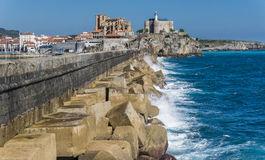 Breakwater Castro Urdiales and cathedral Stock Photography