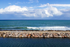 Breakwater and clouds Royalty Free Stock Images